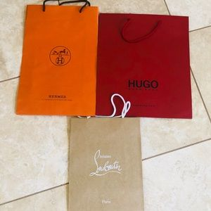 Louboutin Hugo Boss Hermès shopping bags